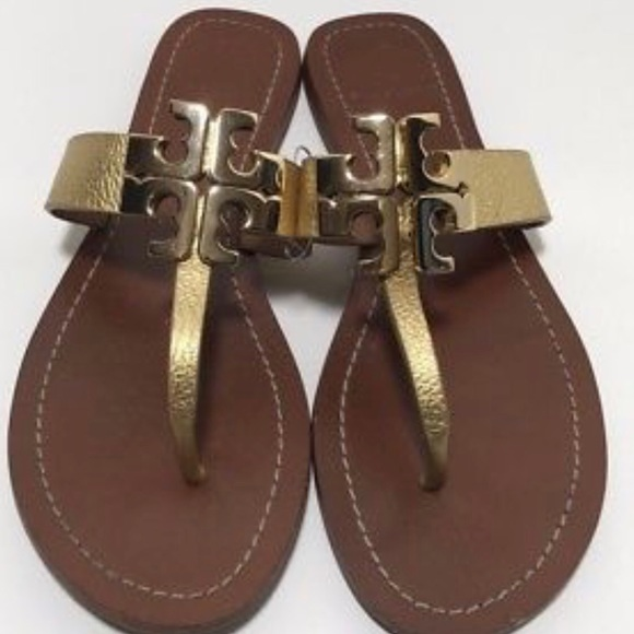 e624ab8e3d7374 Tory Burch - Moore metallic gold thong sandals. M 5a836a89b7f72bae1f621133